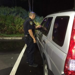 Officer Morgan talks to a driver who was speeding on UNF Drive.   Photo by Patrick Lloyd