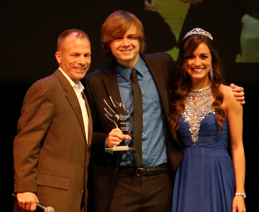 Osprey of the Year award recipient Stephen Putnam stands with Athletic Coach of the Year award recipient Matthew Driscoll (left) and  SG Director of Communications and Marketing Gracie Lopresti (right). Photo by Aidan Scurti