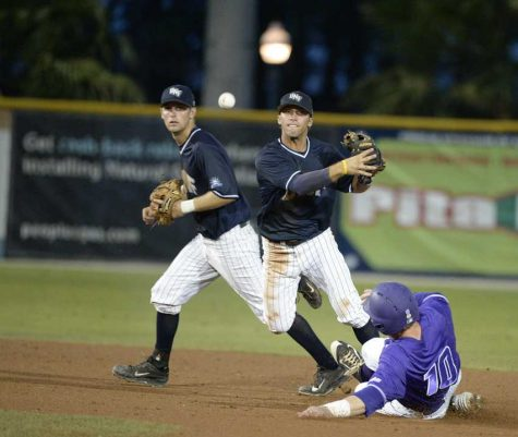 UNF shortstop Kyle Brooks attempting to turn a double play during the conference final in Fort Myers, Fla.  <br><i>Photo courtesy asunphotos.com</i></br>