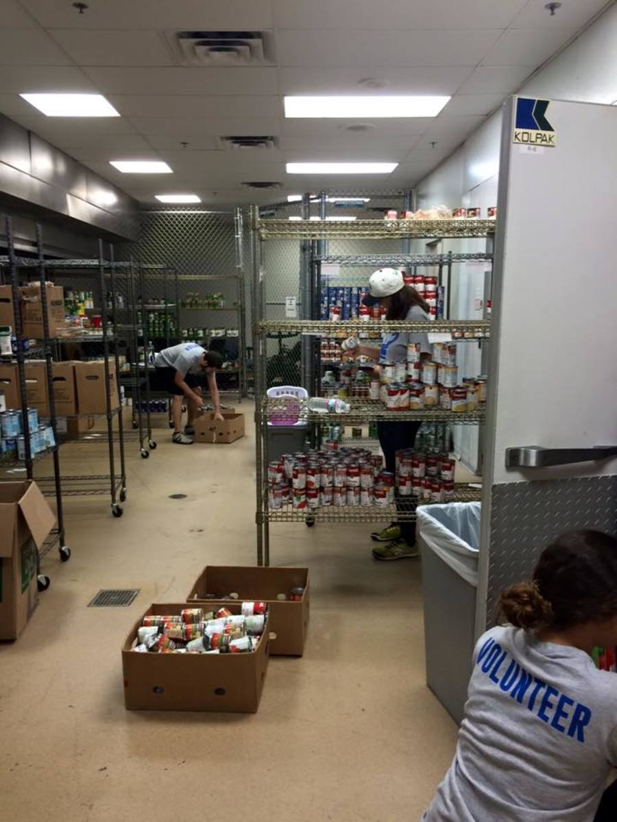 Volunteers sort through donations to stock the pantry shelves.Photo courtesy Facebook