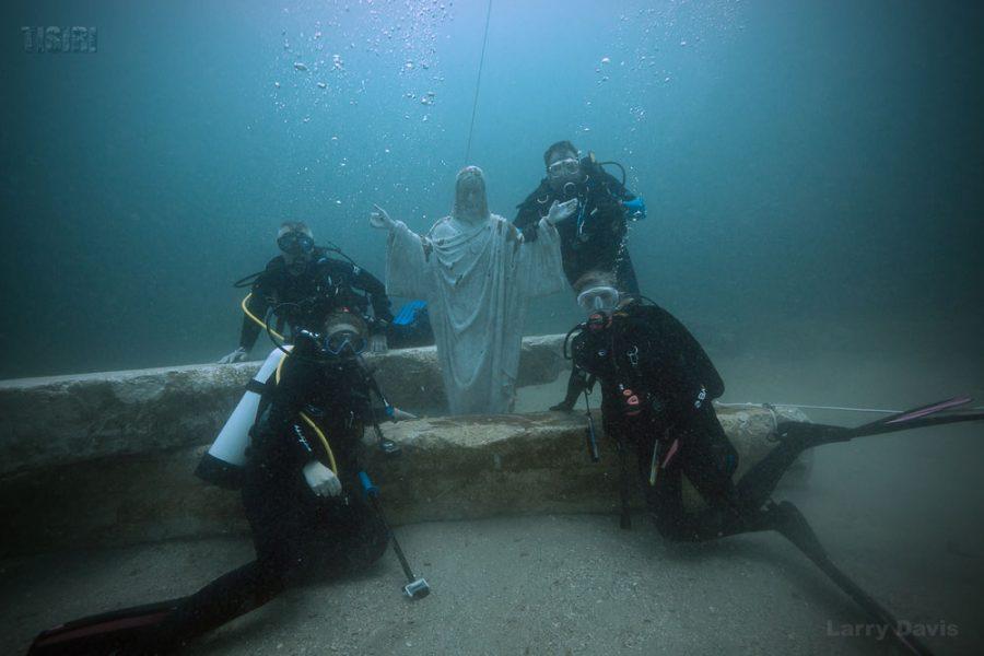 Ed Dendor, Jack Leone, Emily Leone, and Elizabeth Leone with the memorial Jesus statue. Photo courtesy TISIRI.org