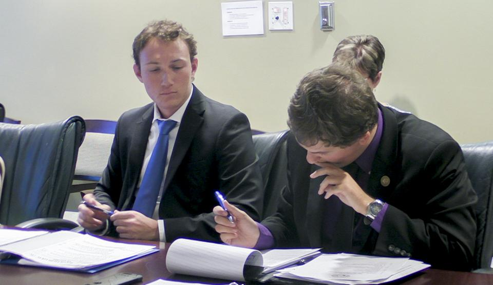 USAC members Austin Daniels (left) and Christopher Jordan (right) review a bill for approval.Photo by Christian Ayers