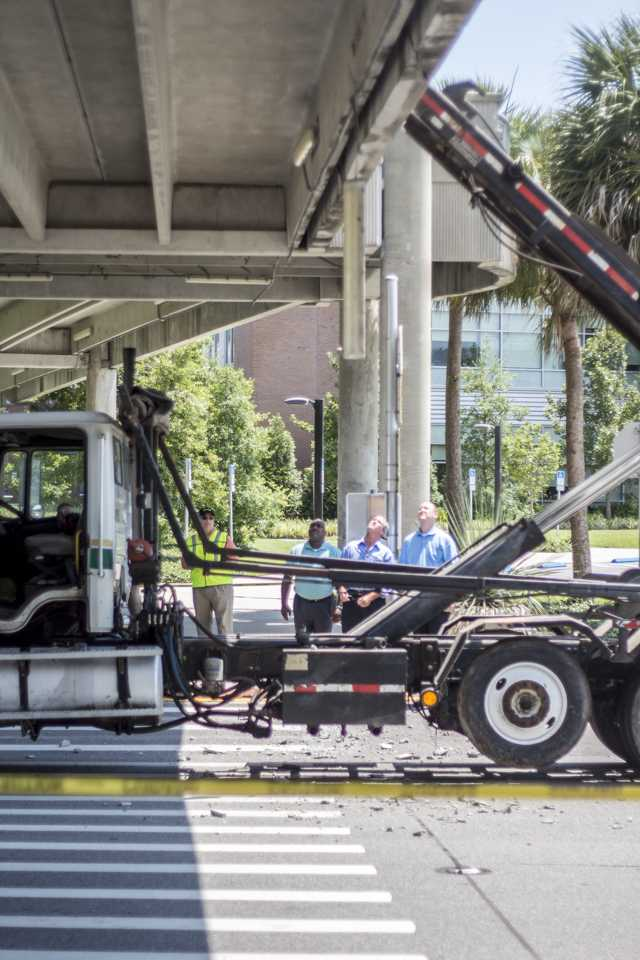 UNF officials inspect the overhead walkway's structural integrity. Photo by Michael Herrera