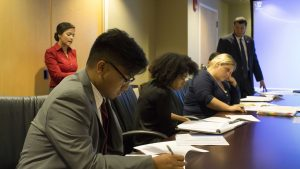 From left to right: BAC members listens to Andrea Schuck's funding request presentation.