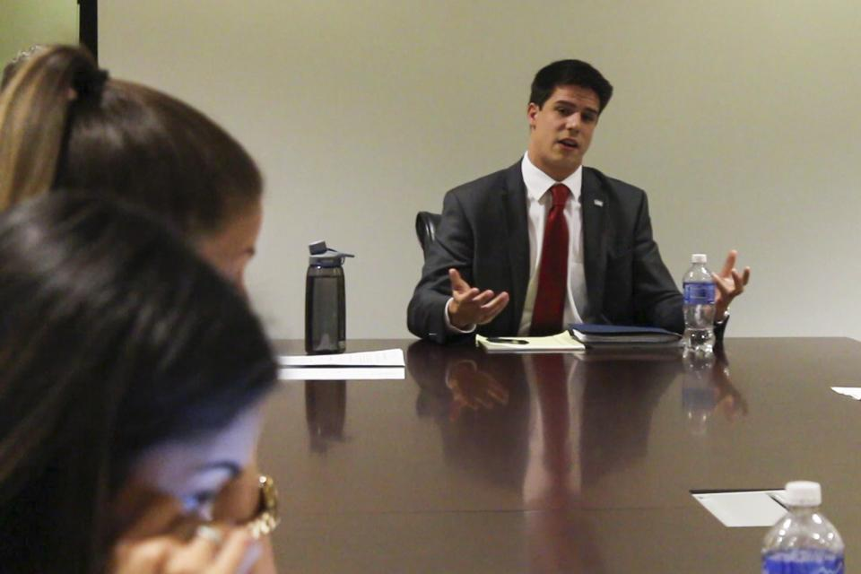 Chief of Staff Jordan Wilson qualifies himself to the Government Oversight Committee for the position of Student Body Vice President.  Photo by Michael Herrera
