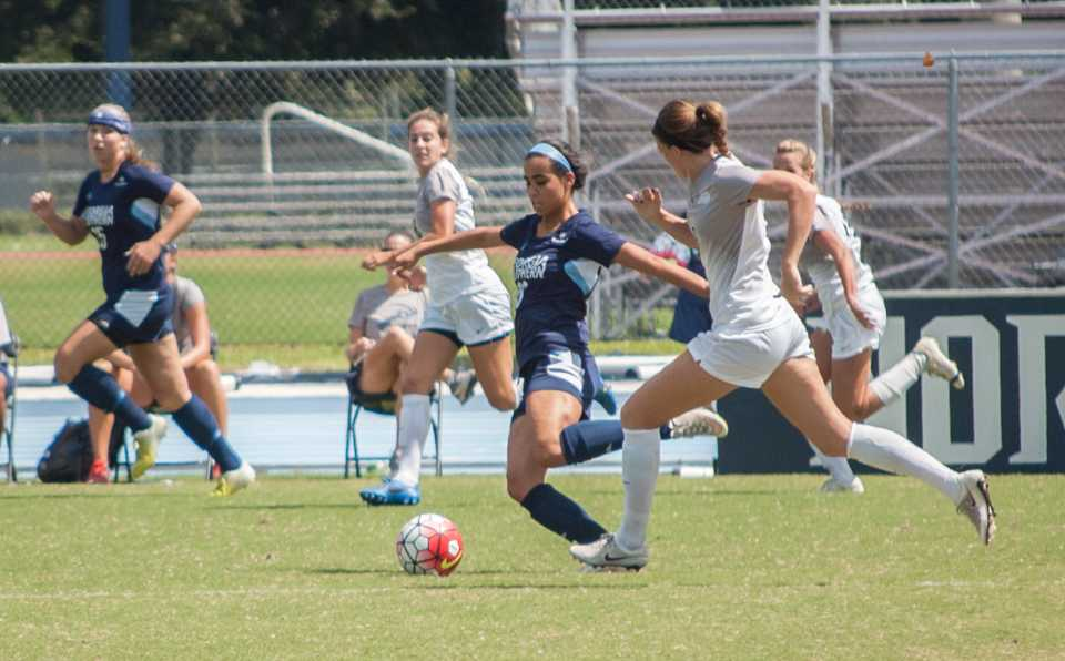 GSU senior forward Nora El-Shami drives the ball away from the Ospreys.  <i>Photo by Joslyn Simmons</i>