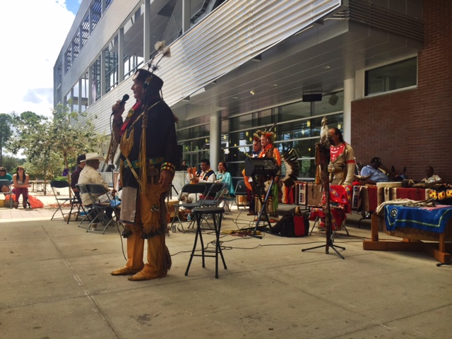 Dave WhiteWolf, a flutist and historian, was a storyteller during the celebration. Students and others leaned in close to hear Native American tales.  <i>Photo by Rachel Cazares</i>
