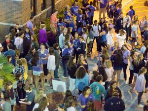 Students wait in Osprey Crossings to march across campus to show support for survivors and raise awareness about domestic violence. Photo by Michael Herrera