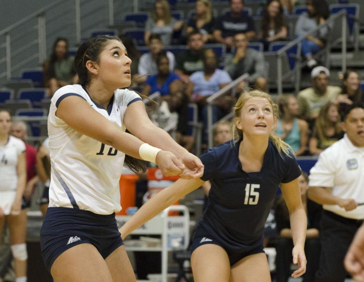 UNF defensive specialists Ashley LaBorde and Kimberly Ferguson. Photo by Ashley Saldana.