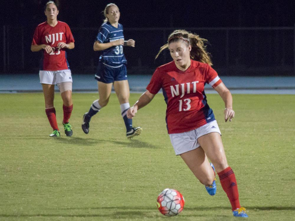 NJIT's Alex Adam rushes the Ospreys in an attempt to break their defense.