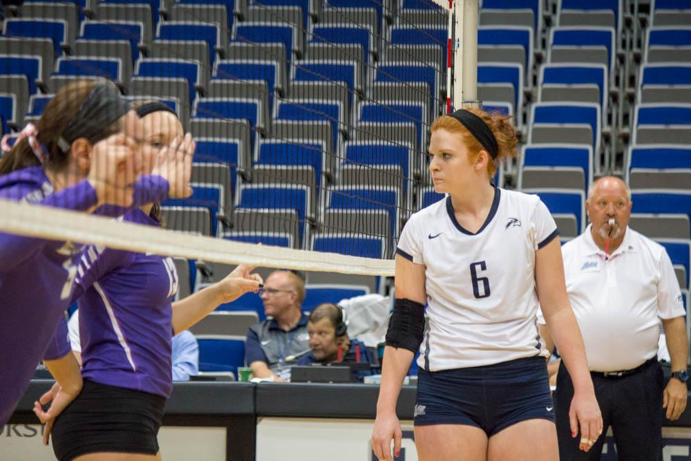 UNF setter Abby Fesl observes the competition.   Photo by Michael Herrera