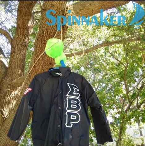 The torn jacket from a multicultural fraternity (Sigma Beta Rho) was found hung by a tree near the Green this morning. Photo by Blake Allen