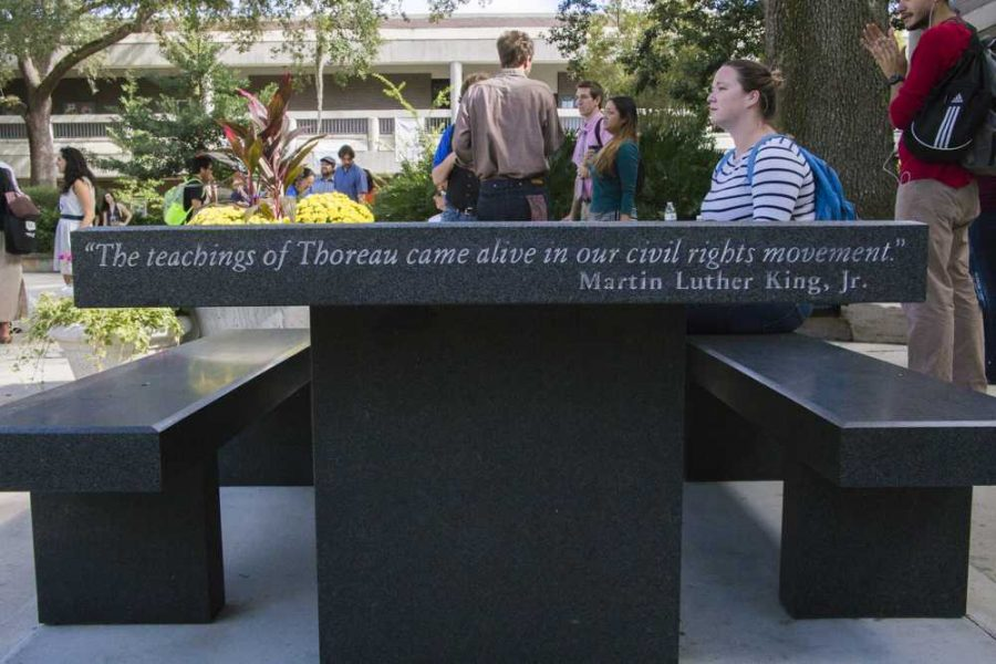 Quotes from Mahatma Gandhi and Martin Luther King are engraved on the sides of the table.    Photo by Caleb Moseley