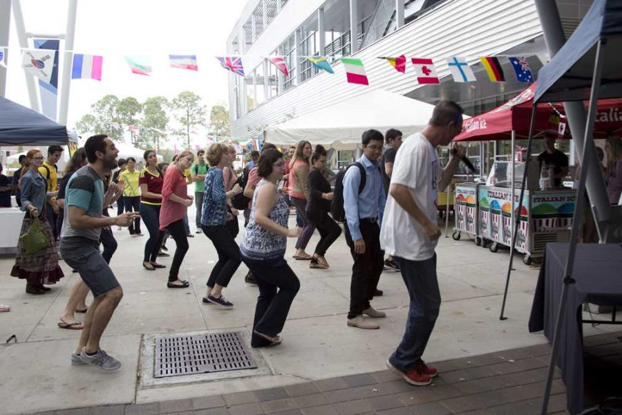 """The DJ led a couple students and teachers in the """"Cha Cha Slide."""" Photo by Kimberly Appleby"""