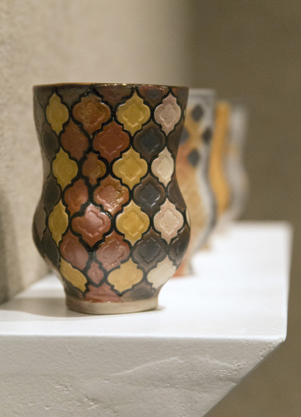 "Abdulhalim's creation ""Cups"" was made from a lengthy and unorthodox process. After creating the forms with clay, she made a plaster of them that she painted and baked onto the clay. After three more firings, glaze, and added copper, we have the final product. Photo by Rachel Cazares"