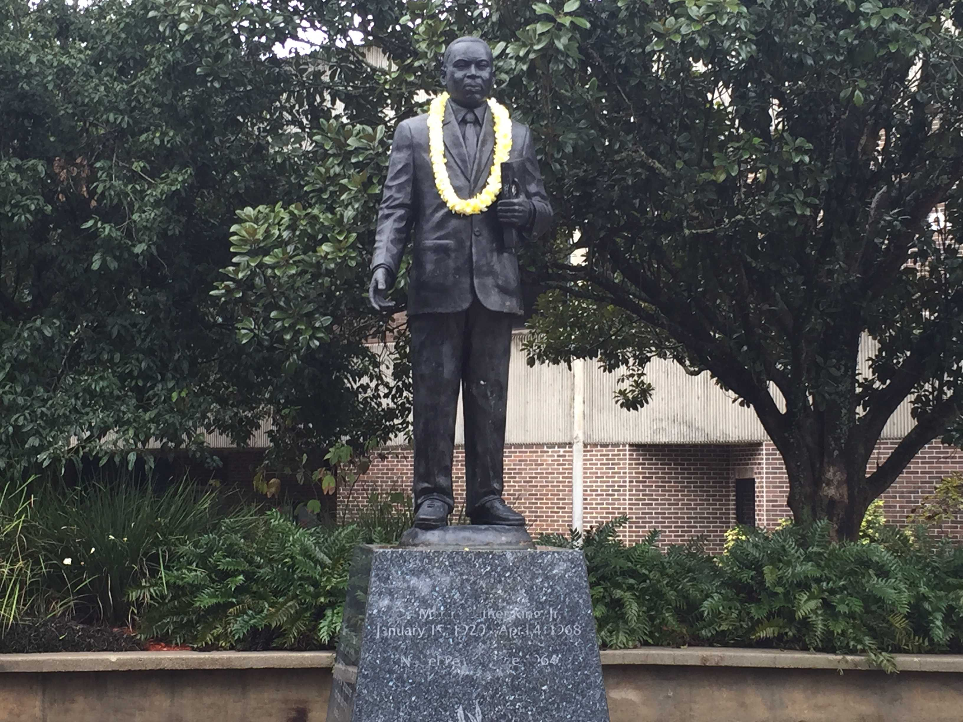 To close out the celebration, a lei was garlanded onto the statue of Martin Luther King Jr. in UNF's Peace Plaza. <i> Photo by Jordan Perez</i>