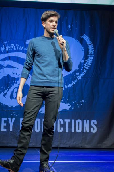 """Mulaney relied on his boyish charm for humor Saturday night, while comparing his alma mater to a """"coke head relative"""" and lauding UNF students for being heroes in the police reports in Spinnaker. Photo by Kristen Smith."""