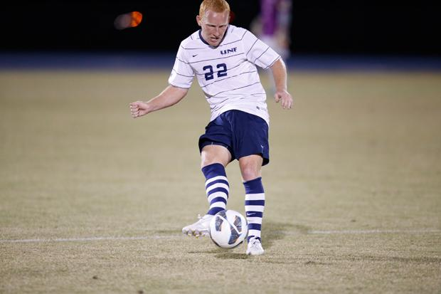 Jay Bolt pushes the ball forward, looking to attack. Photo by Joshua Brangenberg