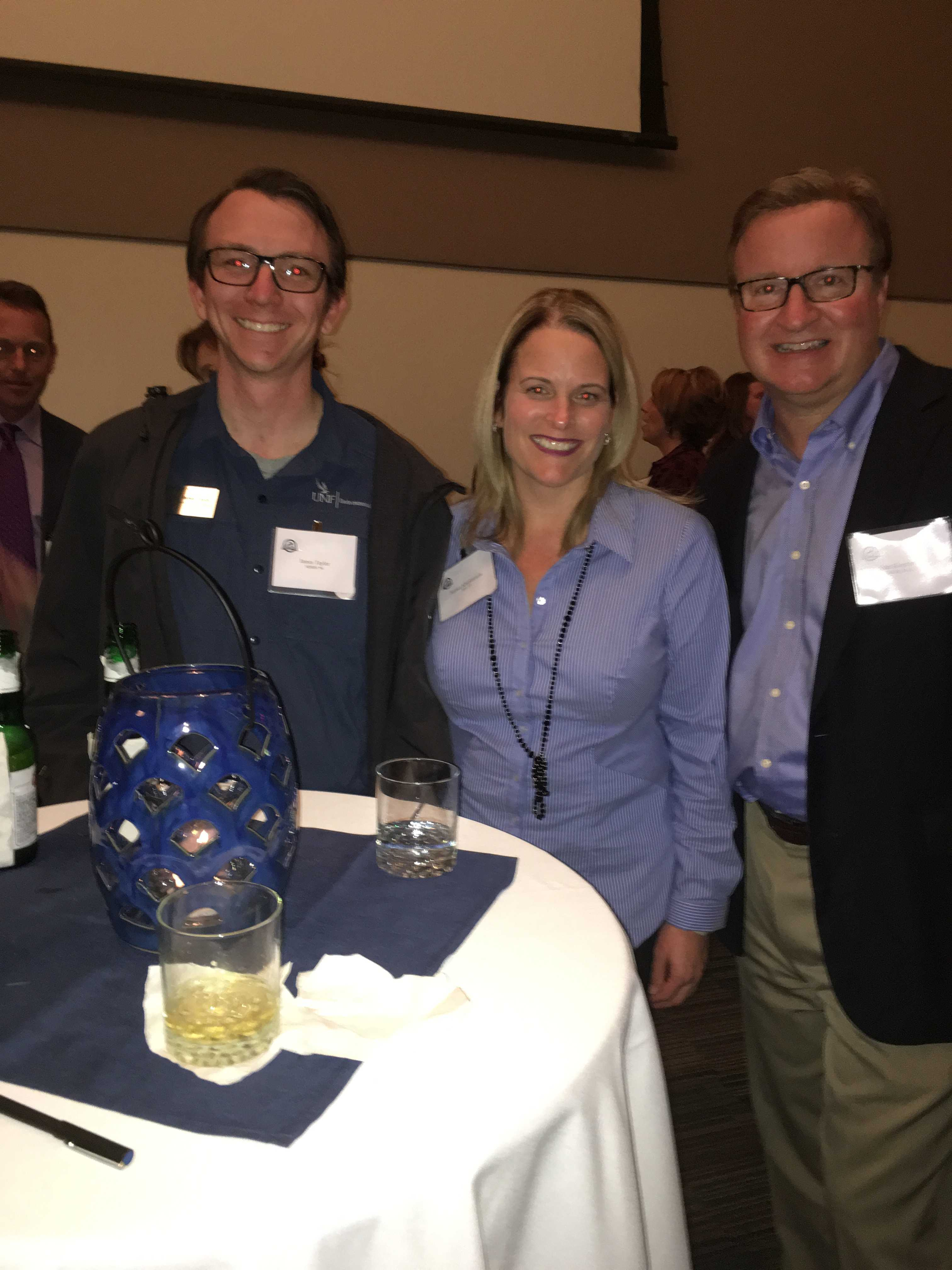 UNF Alumni James Taylor, Jessica Klopfstein and John Klopfstein enjoy the cocktail reception before the ceremony. Photo by Jordan Bebout
