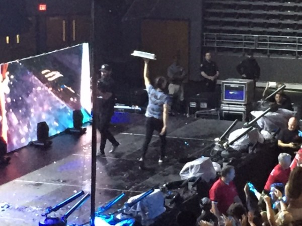 Aoki threw a total of nine cakes into the crowd for a sticky surprise. Photo by Rachel Cazares.