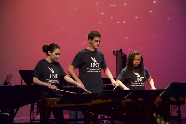 Three percussionists open rehearsal with their first piece for the concert. Photo by Rachel Cazares.