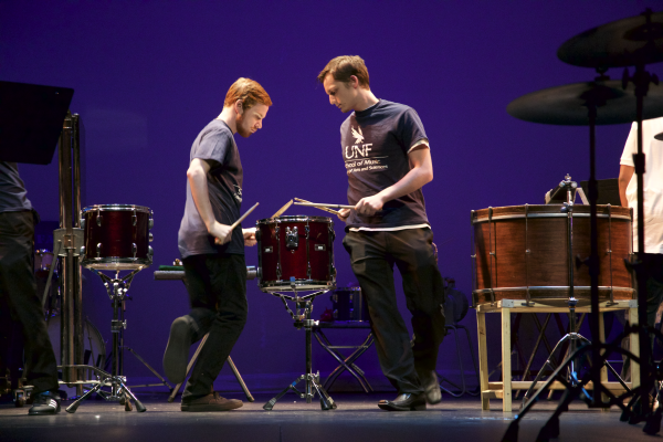The percussionists had a routine while they played, reaching over and playing the drum next to them and rotating around one together. Photo by Rachel Cazares.