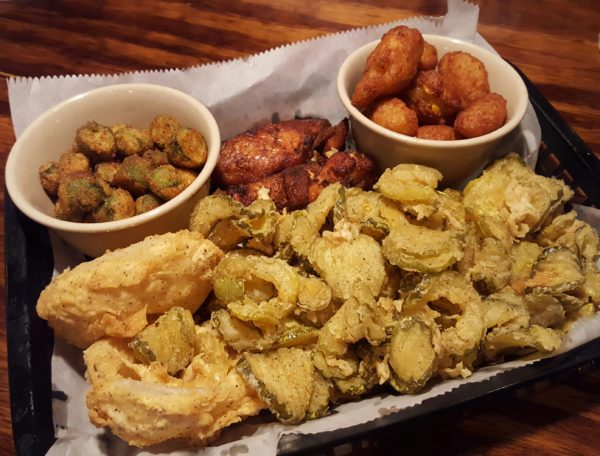The appetizer sampler features portions of traditional southern food including fried okra and corn nuggets. Photo by Courtney Stringfellow.