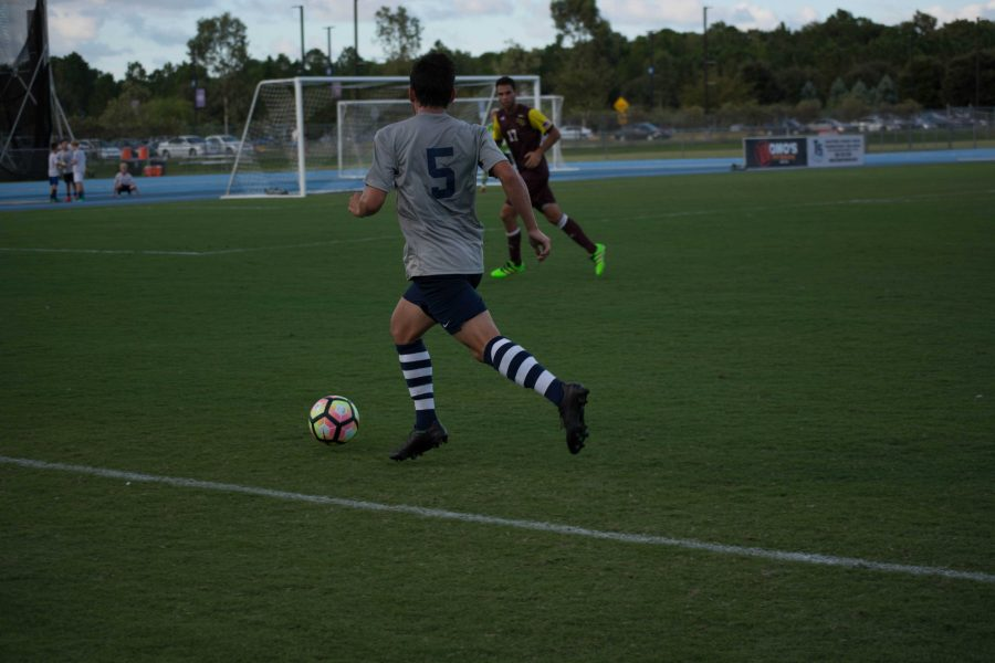 Josh Castellanos dribbles forward against Winthrop.  Photo by Lili Weinstein