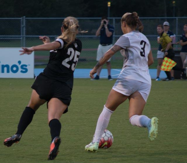 Senior midfielder Alexis Bredeau scores the game-winning goal. Photo by Lilli Weinstein