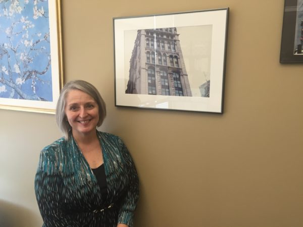 Knipe standing next to the photo in her office. Photo by Nick Blank
