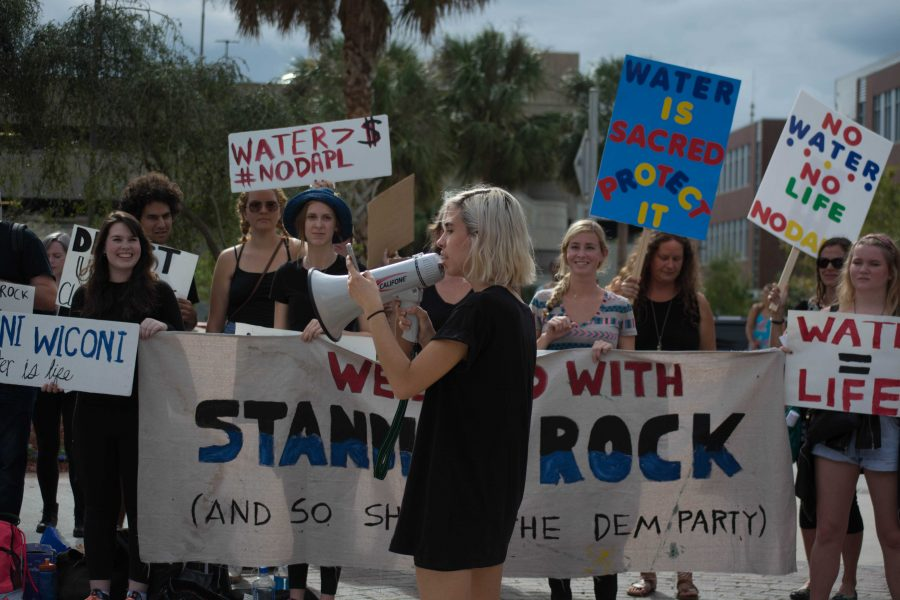 Students protest outside of the Hillary Clinton rally on campus. Photo by Lili Weinstein