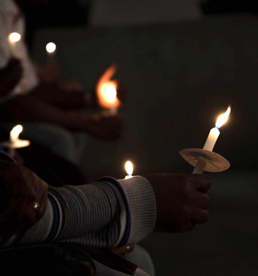 Members of the UNF community held a candle light vigil to honor George Louissaint Jr. Photo by Lili Weinstein