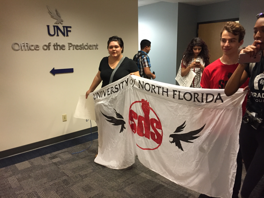 Members of the SDS stand outside President Delaney's office. Photo by Pierce Turner