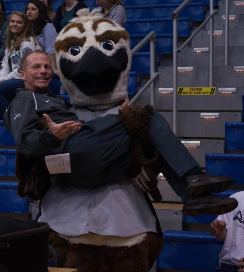 Men's basketball head coach Matthew Driscoll with Ozzie. Photo by Lili Weinstein.