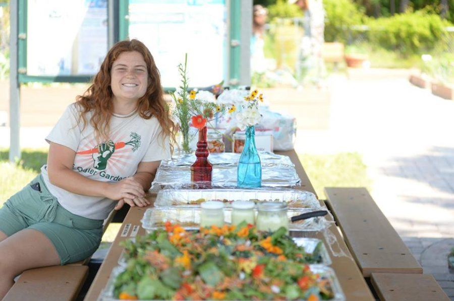 Mallory Schott shows off some of the crops grown at the Ogier Gardens. Picture courtesy of the UNF Ogier Gardens