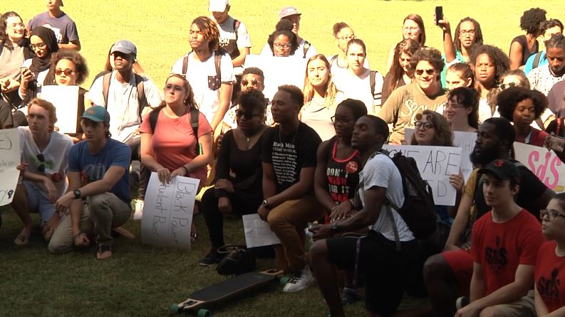 Many students took a knee on the Green during the BLM protest. Photo by Andy Castro