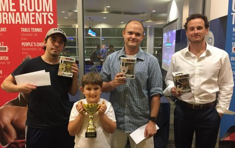 The winners and their prizes (From left to Right) Tereance Keller and his son, Charlie Nuzum and Matthew Smith. Photo by Tristan Reyes.