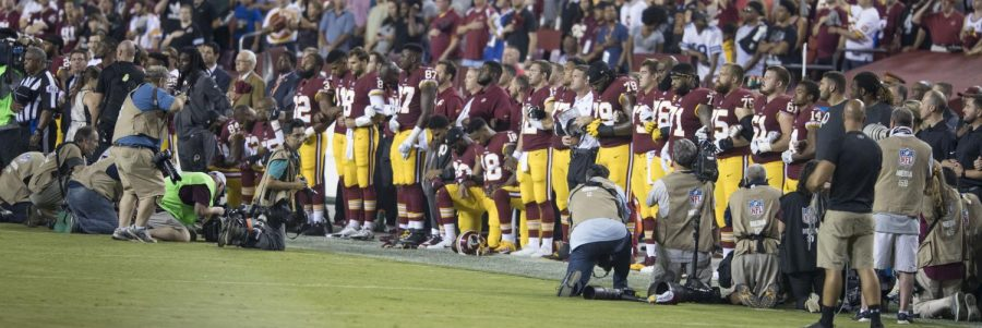 Some players from the Washington Redskins kneel during the national anthem. Photo courtesy Creative Commons