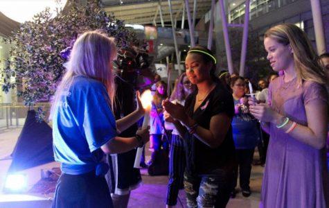 Students lit candles. Photo by Jesse Martinez