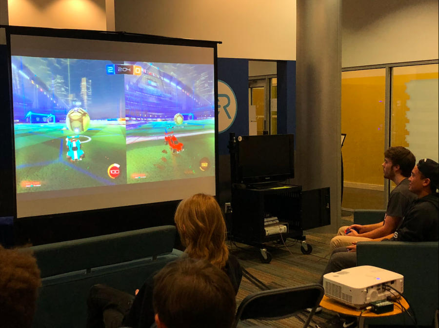 Students gathered in the Game Room to play Rocket League.