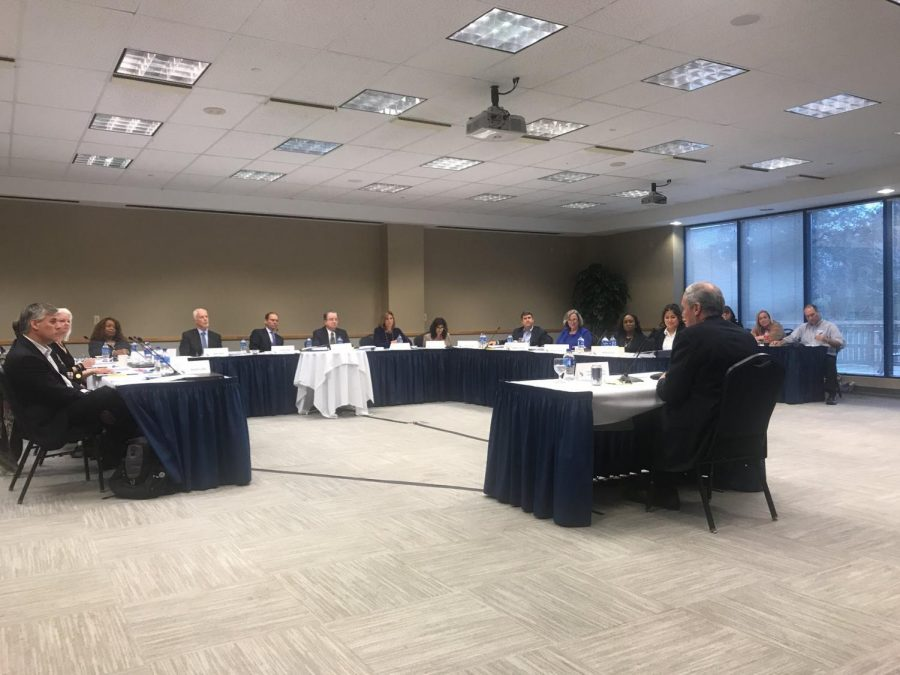 The Presidential Search Committee interviews candidate David Szymanski. Photo by Colin McCann.