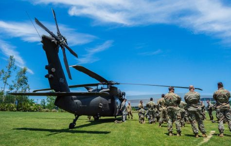 Members of the UNF Army ROTC surround the Blackhawk Helicopter.