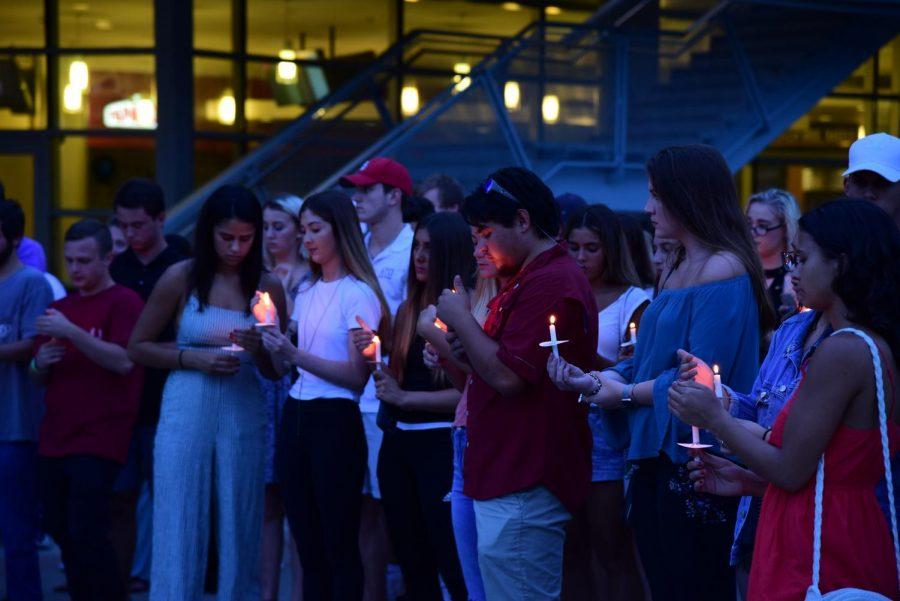 Students come together at a vigil for 20-year-old Hayden Raulerson.