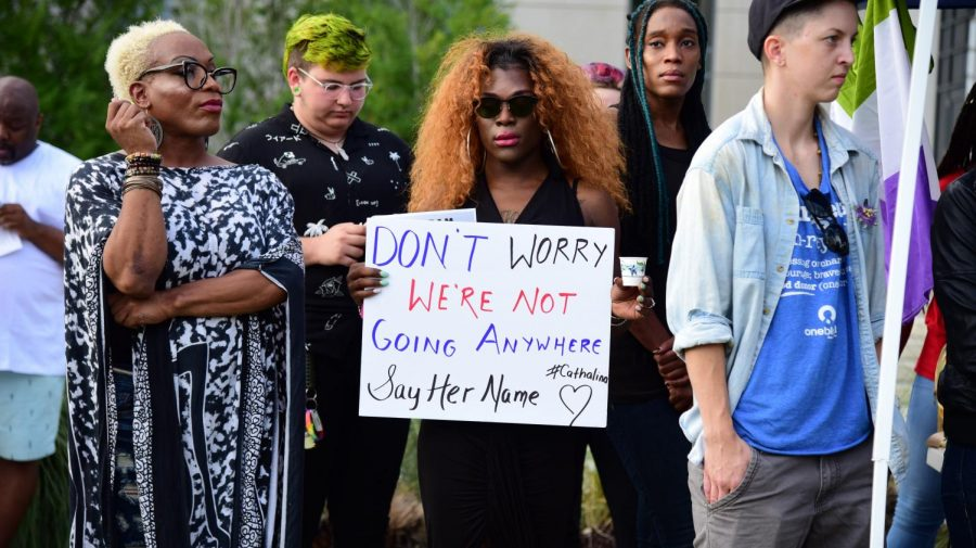 Activists gather outside of the Duval County Courthouse in response to the recent death of transgender community members.