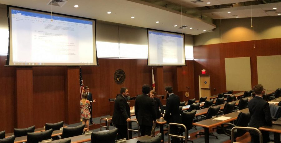 Senate members discuss business during the meeting. Photo by Alan Vargas.