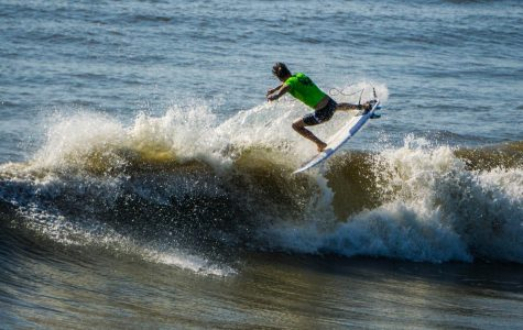 Another surfer hits the waves.