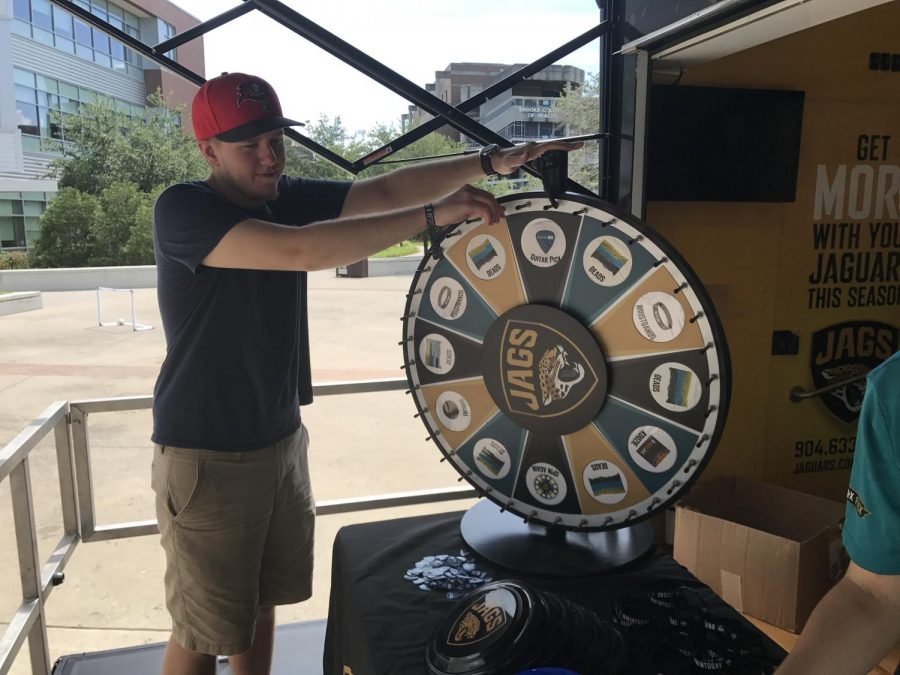 Students could spin prize wheel and win Jaguars swag Photo by Drew McDonald
