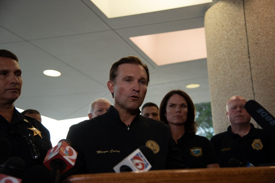Mayor Lenny Curry addresses the media the evening after a mass shooting at the Jacksonville Landing.