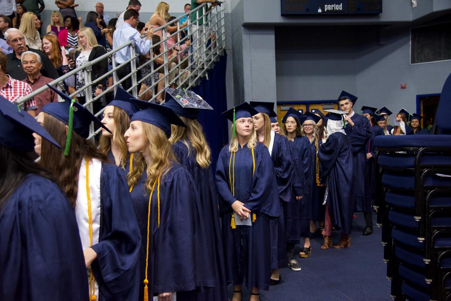 Graduates+walking+out+to+begin+the+ceremony.
