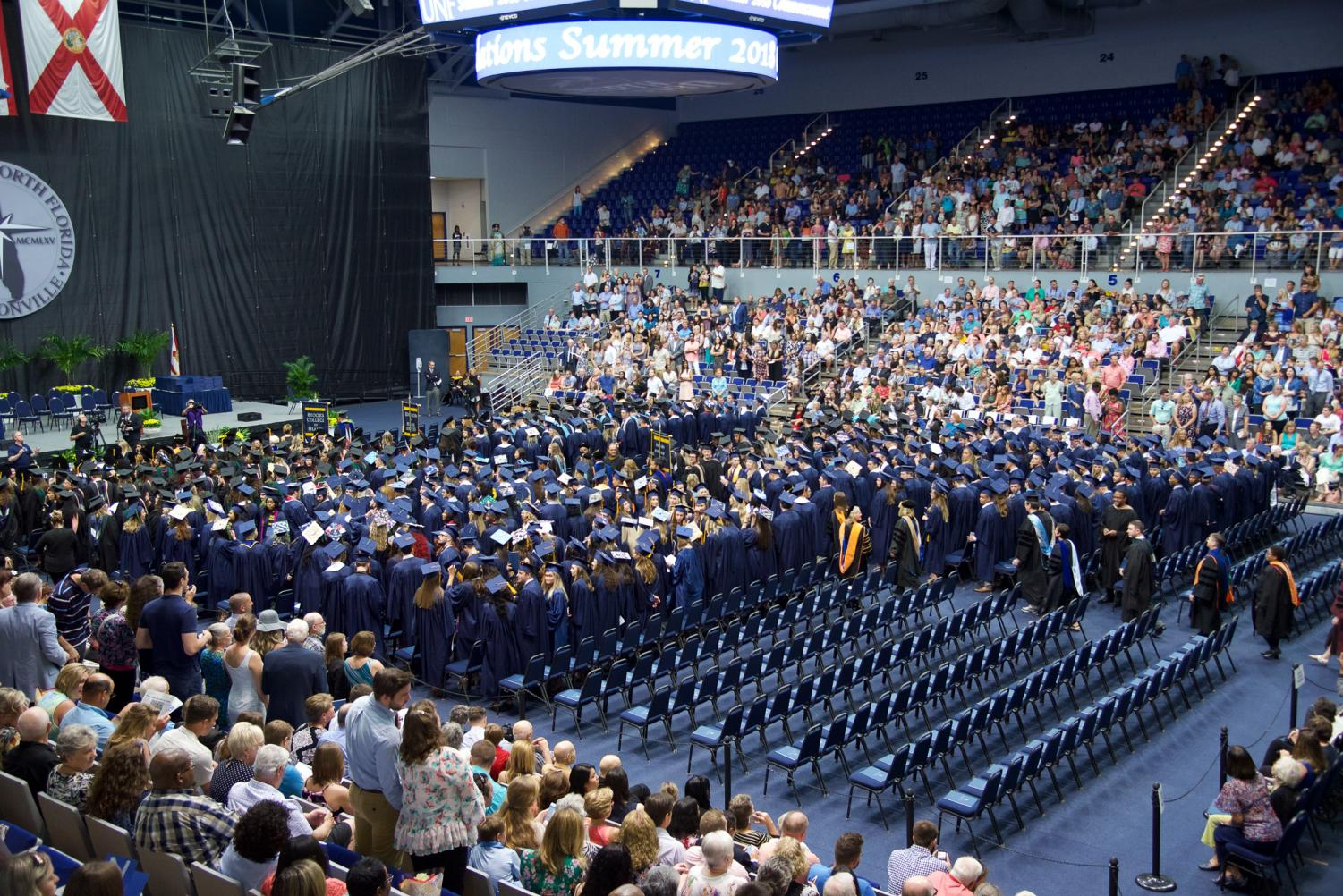 Graduates+surrounded+by+proud+friends+and+family.